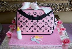 Pink diaper bag baby shower cake with booties.JPG