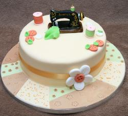 Sewing theme cake with Singer machine on top with buttons threads.JPG
