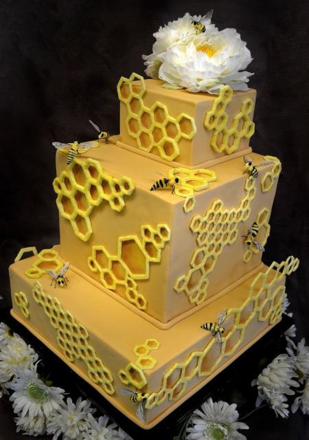 ... rectangular yellow cake w/ honeycomb theme w/ white flower at the top