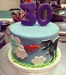 T-Rex theme round 30th birthday cake with number 30 on top.JPG