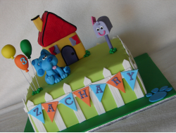 Square children birthday cakes blue clues theme with blue in front of its house with mail box.PNG