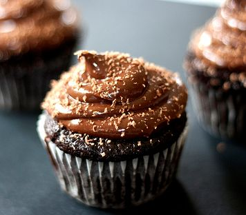 Dark chocolate cupcake with milk chocolate shavings on top.JPG