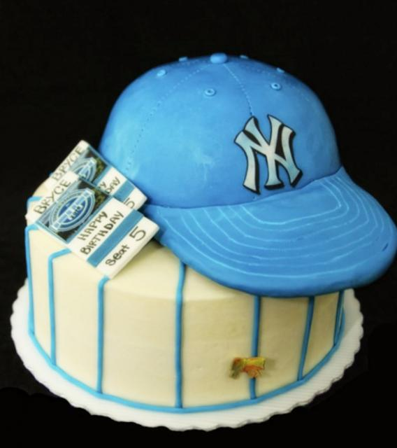 NY Yankees cake with blue cap and tickets on top.JPG