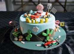 Cars theme birthday cake for 2-year-old with Lightning McQueen on top.JPG