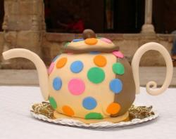 Cool teapot birthday cake with pokadots.JPG