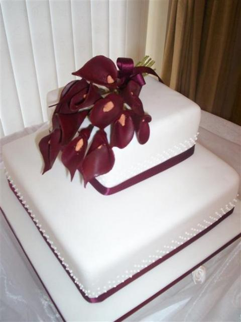 square Weddding Cakes with dark red flowers topper