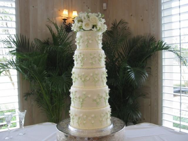 5 tiers Wedding cake in ivory with floral topper