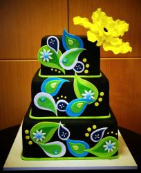 Unique 3 level black cake with green raindrops decor and large yellow flower on top.JPG