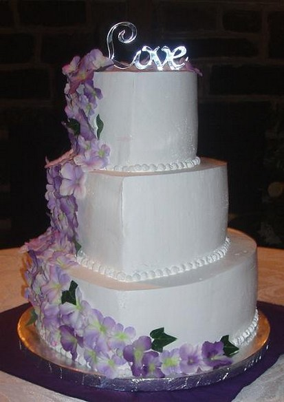 Wedding Cake In White With Purple Flowers