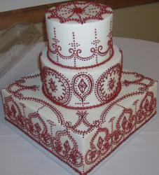 unique Wedding cake design with red patterns and white cake