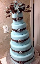 5 Tier Round Light Blue Wedding Cake with Brown Bows & Flowers on top.JPG
