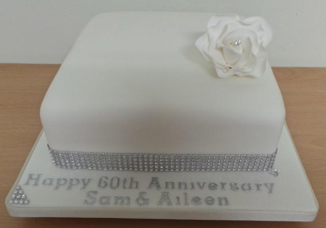 Smooth square 60th wedding anniversary cake with white flower and ...