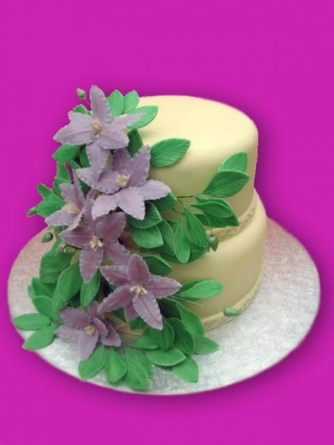 two tier purple and green wedding cakes wedding flowers cake with two tier and purple flowers and 21344