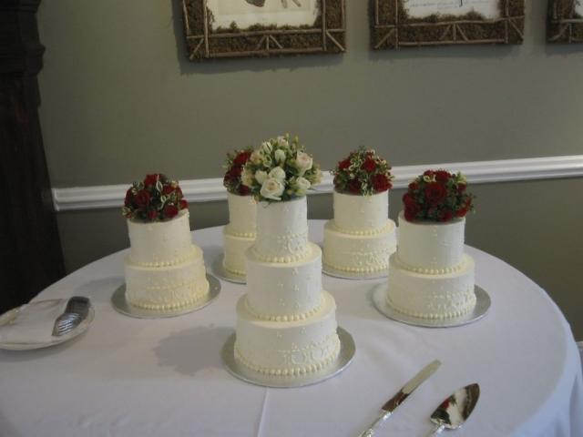 Wedding Mini Cakes In White With Dark And White Flowers On Topper Picture