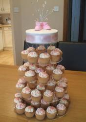 Baby shower cupcakes tower with pink shoes.JPG