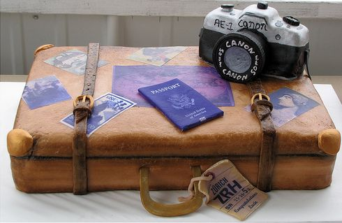Cool graduation cake with camera and suitcase and passport.JPG