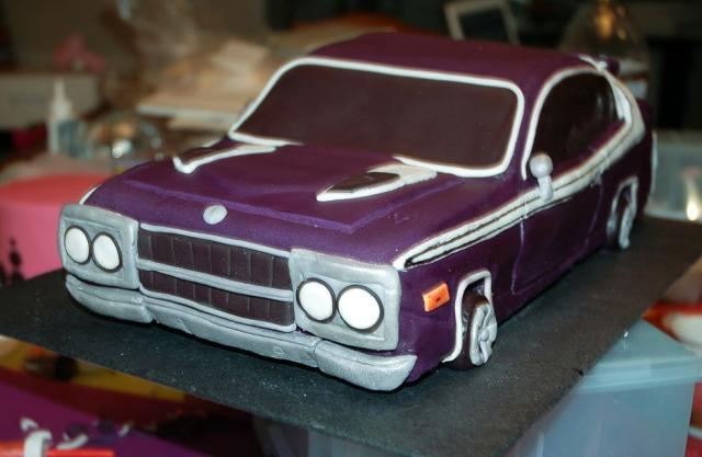 Photograph of Purple car birthday cake