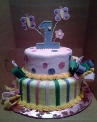 2 tier pink and yellow flower and butterfly theme first birthday cake for girl.JPG