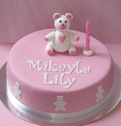 Cute round pink first birthday cake with teddy bear topper.JPG