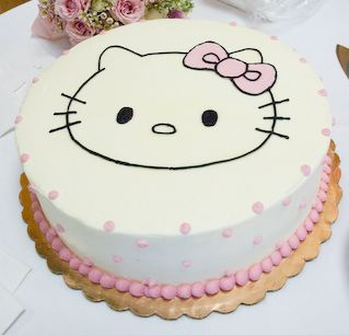 White Hello Kitty cake with pink pearls.JPG