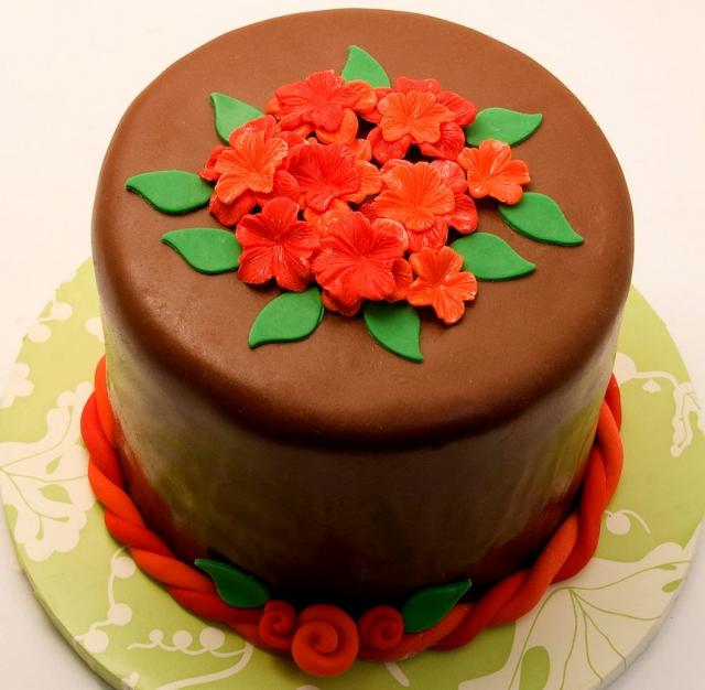 Round chocolate cake with orange flowers.JPG Hi-Res 720p HD