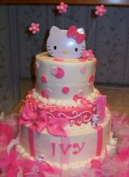 Three tier pink and white Hello Kitty cake.JPG