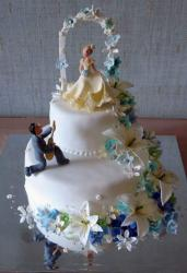 romantic wedding cake with bride and groom figures