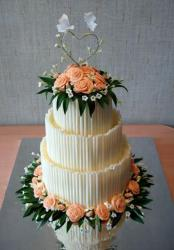 orange flowers wedding cake