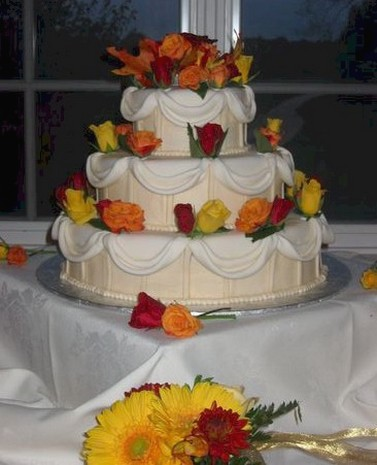 Fresh colorful flowers wedding cakes in three tier in white and cream color cake