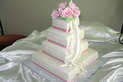 princess wedding cakes in four tier with fresh pink roses topper
