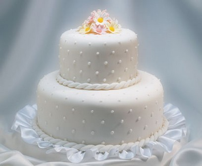 trendy wedding cakes with dots decor with colorful flowers topper in orange