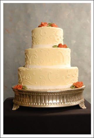 Simple And Elegant Wedding Cake With Orange Flowers