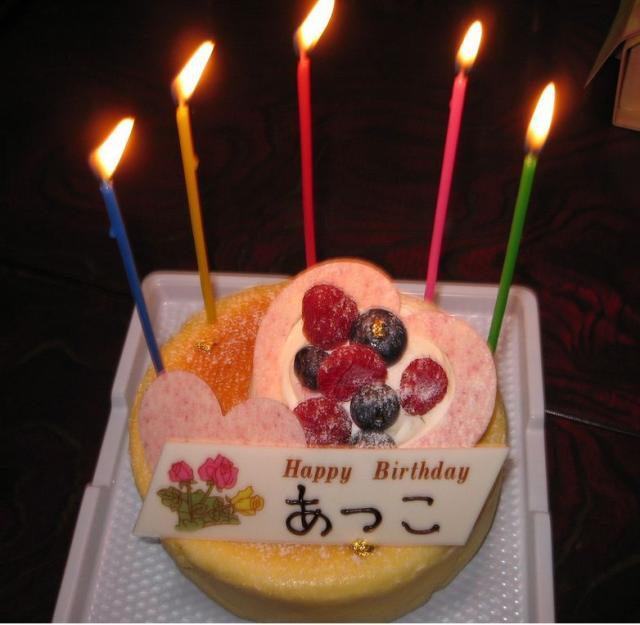 Birthday flan cake with lit candles.JPG Hi-Res 720p HD