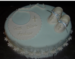 Cute boy baptism cakes with bipe and baby shoes.PNG