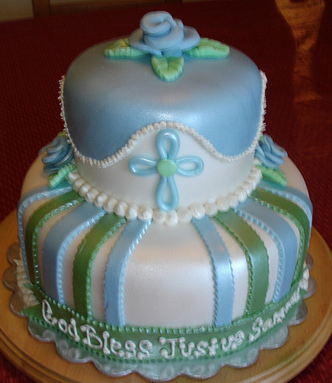 Fancy baptism cakes in two tiers in blue and green colors and flower cake topper.PNG