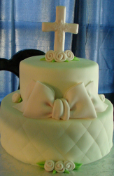 White batism cakes with cross cake topper with big bow.PNG