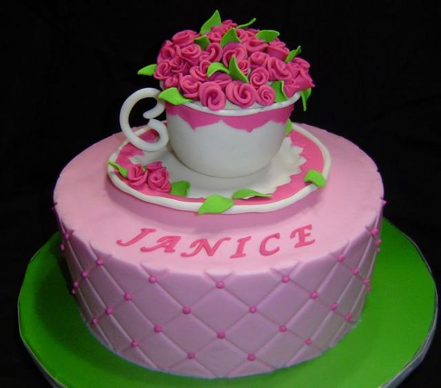 Photo of White + pink tea cup cake