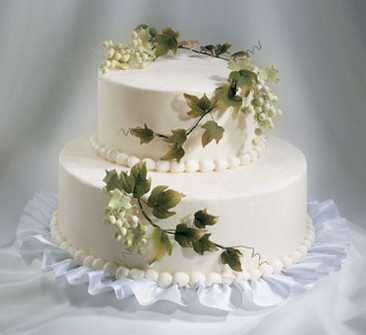 Two Tier Wedding Cakes With White Flowers