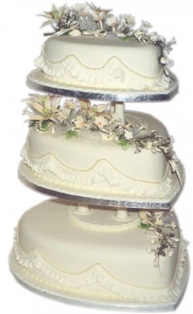 heart shaped wedding cakes with flowers shaped wedding cake with flowers on the tops 15168