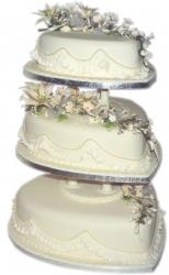 heart shaped wedding cake with flowers on the tops