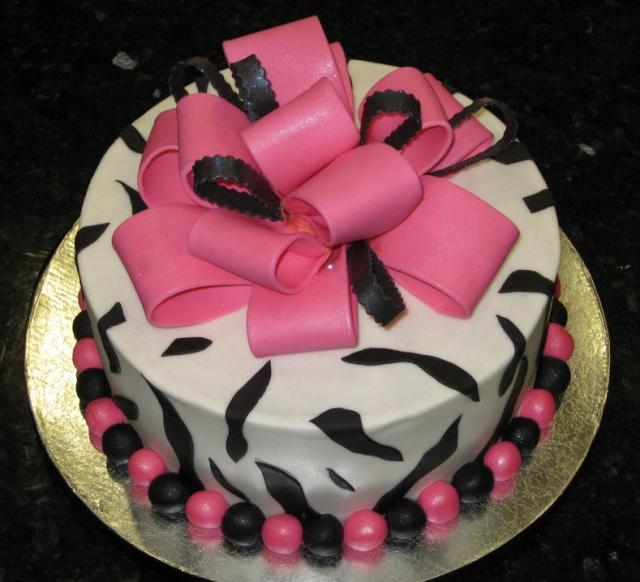 Zebra birthday cake with pink bowtie and beads.JPG