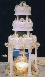 Fancy Wedding Cake in pinkish purple with roses