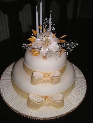 Wedding Cake flower in peach color with candal and floral topper