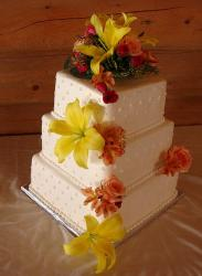 White 3 tier square wedding cake with large yellow flowers and pink roses.JPG