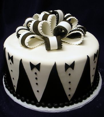 Grooms cake with tuxedo patterns and black and white bowtie.JPG