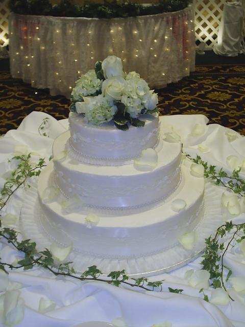 Photo of Wedding Cakes with fresh white roses and rose cake topper