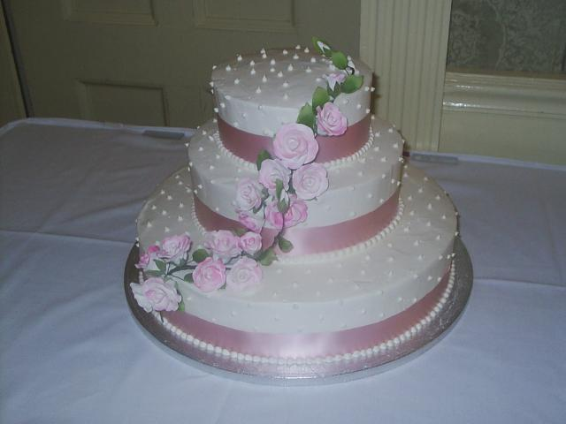 Images of Wedding Cakes  with pink ribbons and light pink roses