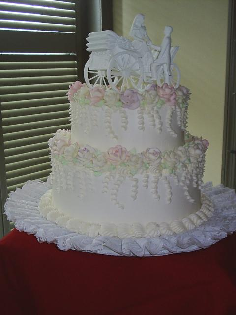 wedding cakes in two tier with pink flowers with fancy