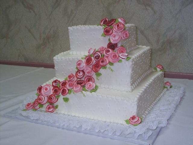 Square Wedding Cakes with pinkish flowers in three tiers