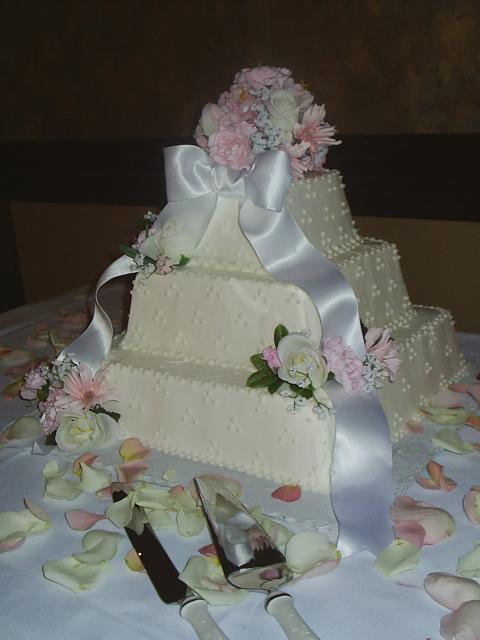 Square Wedding Cakes with pink flowers and white ribbon